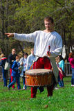 Musician in historical costume performs in a park Stock Image