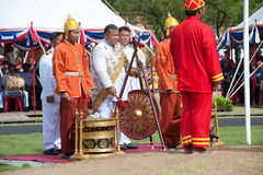 Musician hitting gong in Royal Plowing Ceremony. Stock Photos