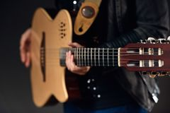 Musician holding the guitar Royalty Free Stock Images