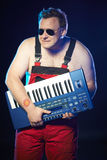 Musician holding a keyboard Royalty Free Stock Photos