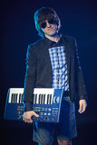 Musician holding a keyboard Royalty Free Stock Photography