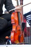 The musician holds the violin in his hands during the break on t royalty free stock image