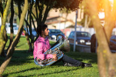Musician instrumentalist with the tuba. Royalty Free Stock Images