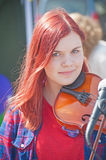 Musician at Inverness Highland Games. Portrait of young woman musician playing the fiddle  at Inverness Highland Games  held on 20th July 2013 Royalty Free Stock Photo