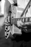 Musician with jazz guitar. Solo musician picking on his electroacoustic jazz guitar Royalty Free Stock Image