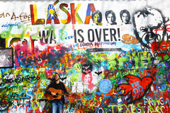 Musician At John Lennon Wall, Prague Royalty Free Stock Photos