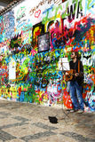 Musician at John Lennon Wall in Prague, vertical Royalty Free Stock Image