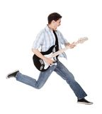 Musician jumping. Young musician jumping with his guitar. Isolated on white Royalty Free Stock Photos