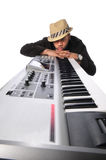 Musician With Keyboard. African American musician with electronic keyboard resting face on hands Stock Images