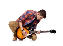 Musician kneels Royalty Free Stock Images
