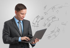 Musician with laptop. Stock Photo