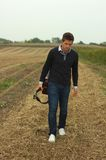 Musician leave field. Young musician leaves field of soy royalty free stock images