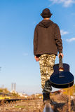Musician leaving Royalty Free Stock Photo