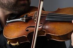Musician man playing the violin. Musical instrument on performer. Hands Stock Photo