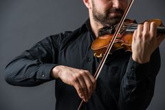 Musician man playing the violin. Musical instrument on performer. Hands. Classic music concept Stock Photography