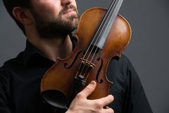 Musician man playing the violin. Musical instrument on performer. Hands Stock Images