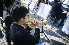 Musician. Melipilla, Chile. July 27, 2017.  Municipal musicians group in public presentation in the square of the Melipilla city , Chile. Here a young trumpeter Stock Photos
