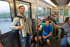 Musician in Metro. PARIS, FRANCE - JULY 28, 2015: A musician is playing accordion in the metro in Paris in France royalty free stock photos