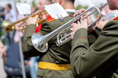 Musician of military orchestra playing trumpet during parade Stock Images