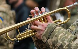 Musician of military orchestra of the Ukrainian army plays the trumpet stock images