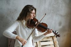 Musician. Beautiful girl with violin Royalty Free Stock Photos
