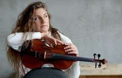 Musician. Beautiful girl with violin Royalty Free Stock Photo