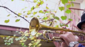 Musician outdoors. Close up male play on the trumpet outdoors stock video
