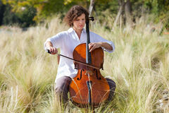 Musician outdoors, portrait Royalty Free Stock Image