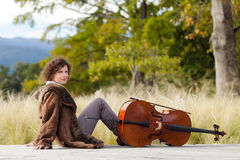 Musician outdoors, portrait. Portrait of young cellist, outdoors royalty free stock photography