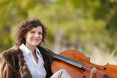 Musician outdoors, portrait. Portrait of young cellist, outdoors royalty free stock images