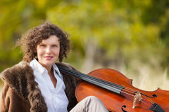 Musician outdoors, portrait. Portrait of young cellist, outdoors royalty free stock image