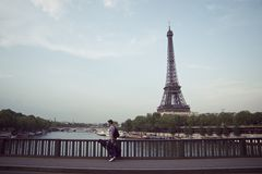 Musician from paris. Musician walking the streets of Paris Royalty Free Stock Image