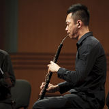 Musician performs English horn on wind music chamber music conce Royalty Free Stock Photo