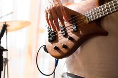 Musician play on bass guitar Stock Images