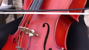 Musician play on cello stock footage