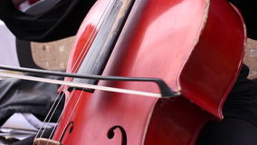 Musician play on cello stock video