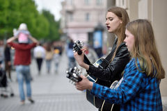 Musician play guitar in Street music day. Unidentified musician plays guitar in Street music day on May 21, 2016 in Vilnius. Its a most popular event on May in Royalty Free Stock Photography
