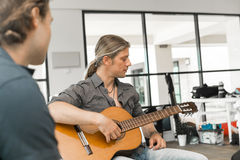 Musician play guitar Stock Images