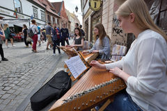 Musician play Lithuanian plucked string instrument. Unidentified musician play Lithuanian plucked string instrument Kankles in Street Music Day on May 20, 2017 Royalty Free Stock Image