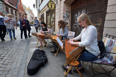 Musician play Lithuanian plucked string instrument. Unidentified musician play Lithuanian plucked string instrument Kankles in Street Music Day on May 20, 2017 Stock Photo