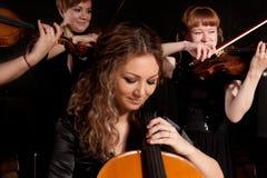 Musician play violin on dark Stock Image