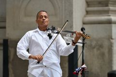 Musician play violin in lower Manhattan, NYC. Unidentified musician play violin in lower Manhattan on August 23, 2017 in New York City, NY. Manhattan is the most Royalty Free Stock Images