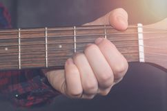 Musician Playing accord. A on acoustic guitar, close up Royalty Free Stock Images