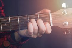 Musician Playing accord. Am on acoustic guitar, close up Stock Photography