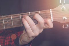 Musician Playing accord. C on acoustic guitar, close up Stock Photo