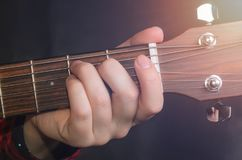Musician Playing accord. E on acoustic guitar, close up Royalty Free Stock Image