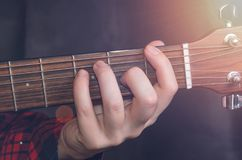 Musician Playing accord. F on acoustic guitar, close up Stock Photo