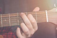 Musician Playing accord. G on acoustic guitar, close up Stock Images