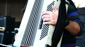 A musician playing the accordion stock footage