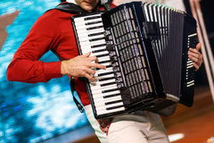 The musician playing the accordion. Closeup detail of hands playing a black accordion instrument royalty free stock image